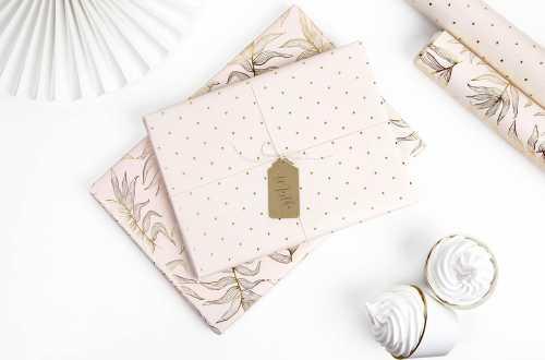 Rouleau de 2 feuilles de papier cadeau - feuilles et pois doré
